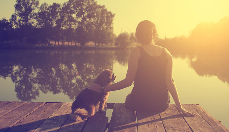 woman and her dog bonding